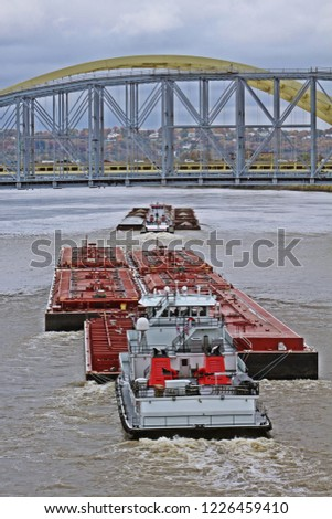 Second barge overtaking the first barge