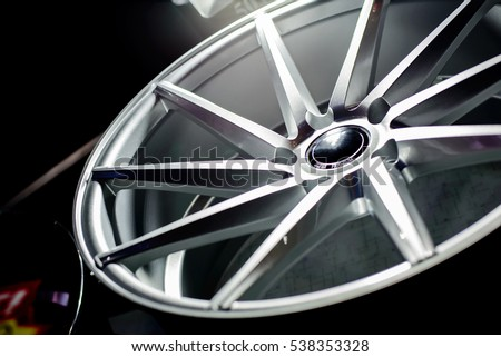 Second hand alloy wheels in store, selective focus.