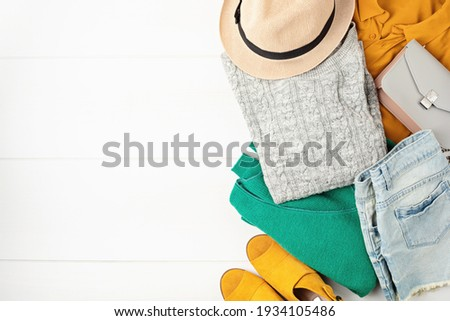 Second hand wardrobe idea. Circular fashion, eco friendly sustainable shopping, thrifting shop concept. Top view over woman outfit. Stockfoto ©