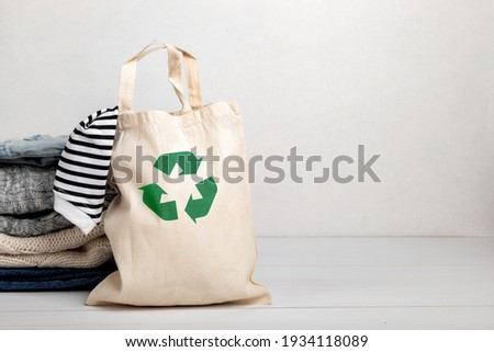 Second hand wardrobe idea. Circular fashion, eco friendly sustainable shopping, thrifting shop concept. Woman outfit. Photo stock ©