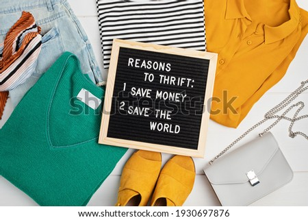 Second hand wardrobe idea. Circular fshion, eco friendly sustainable shopping, thrifting shop concept. Top view over woman outfit. Stockfoto ©