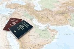 second passport on middle east map in background