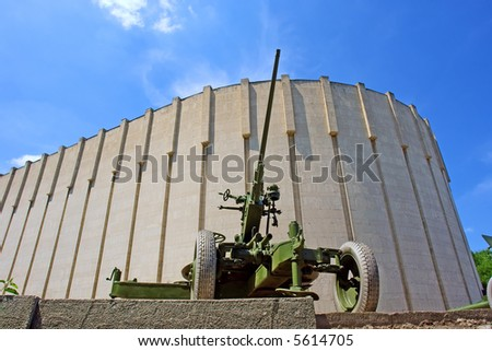 Second world war flak in city park - against bulky building. Shot in June, near Dnieper river (Dniepropetrovsk, Ukraine).