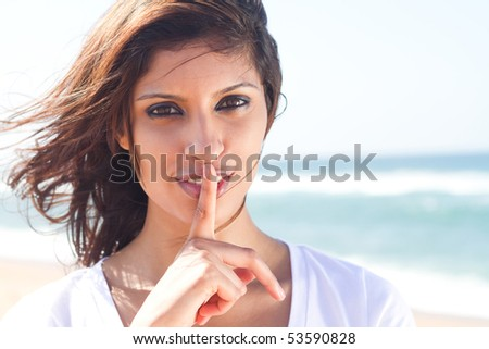 Stock Photo secret: Young girl with her finger over her mouth
