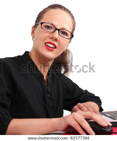 Secretary in glasses in office, working on a laptop
