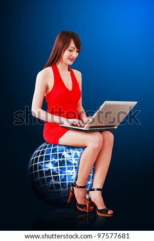 Secretary in red dress on globe and using notebook computer : Elements of this image furnished by NASA
