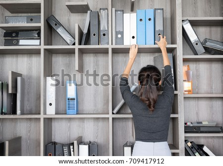 Secretary or Purchasing Manager  in a modern Office shelves room. Setup studio shooting. Foto stock ©