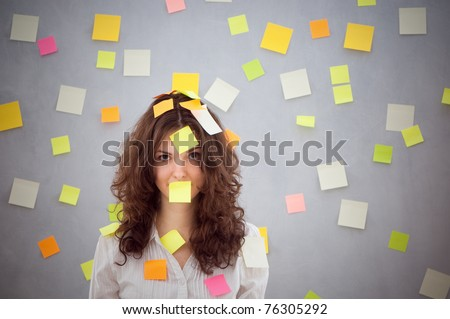 secretary overwhelmed with sticky reminder notes - stock photo