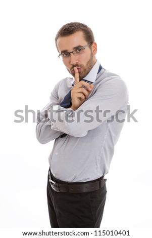 Secretive business man making silence sign over white background.