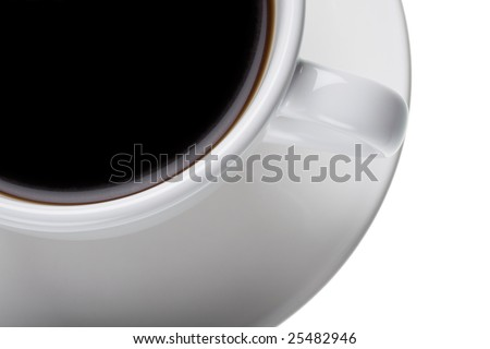 Section of a white cup and saucer with black coffee.