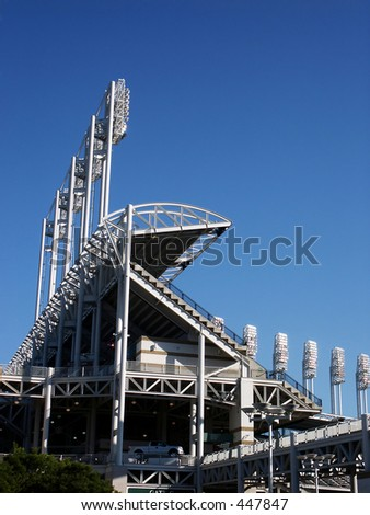 Section of baseball stadium with light towers