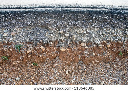 Section of layer asphalt road crack  in a rural area