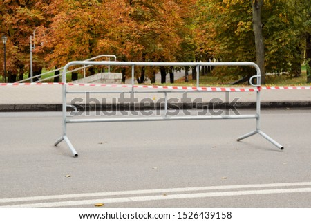 section of metal portable fence in the park before the start of the mass event