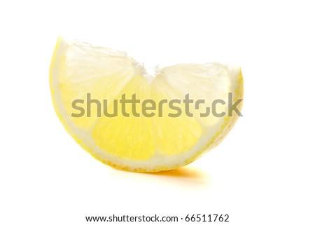 Section of ripe lemon. Isolated on white