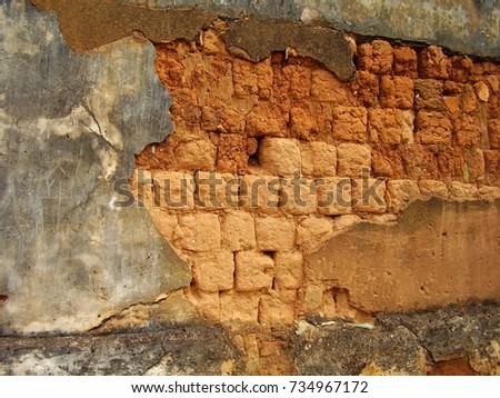 section of weathered adobe wall ...
