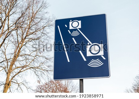 Sectional speed measurement ('Odcinkowy pomiar predkosci' in Polish), average speed check ahead - Polish road sign ストックフォト ©