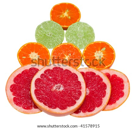 Sections of ripe juicy grapefruit, tangerine and lime on white background. Focus on grapefruit. Isolated.