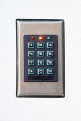 Secure password on keyboard for opening home house door. Isolated. Password code Security keypad system protected in Public Building. The security code combination to unlock the door
