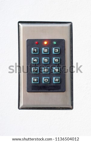 Secure password on keyboard for opening home house door. Isolated. Password code Security keypad system protected in Public Building. The security code combination to unlock the door #1136504012