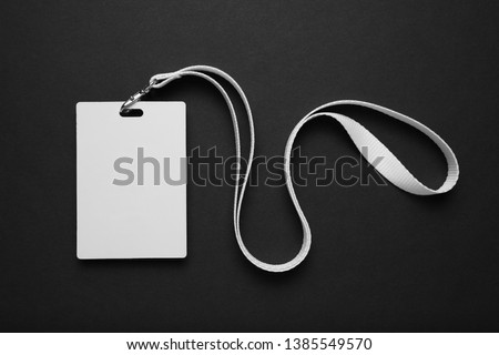 Security badge on black background, lanyard plastic clip, template.