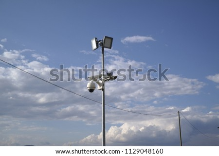 security camera and lamp #1129048160