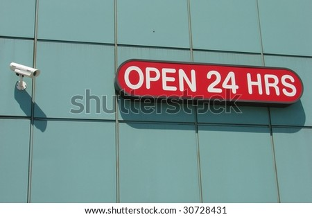 Security Camera and Open 24 Hours Sign