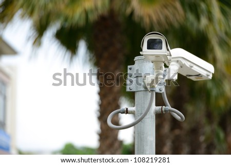 security camera on the pole next to the building