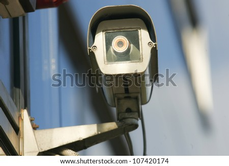 Security camera on the side of an modern building