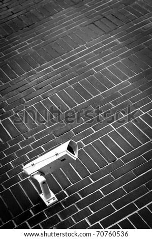 Security camera watching every move - stock photo