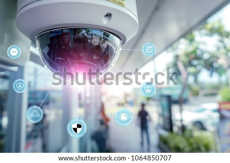 Security CCTV camera and icons at front of Supermarket.Security systems and protection from theft.Intelligent camera can record video at any time by automation.Digital Eyes.Surveillance