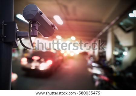 Security CCTV camera or surveillance system in car park, Intelligent cameras can record video all day and night to keep you safe from thieves. Surveillance camera Anti-theft system concept.