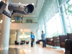 Security CCTV camera or surveillance system in office building, Intelligent cameras can record video all day and night to keep you safe from thieves. Surveillance camera Anti-thieft system concept.