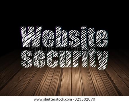 Security concept: Glowing text Website Security in grunge dark room with Wooden Floor, black background