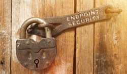 Security concept. There is a lock on the door on the metal part of which it is written - ENDPOINT SECURITY
