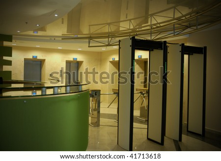 Security entrance in business building with security check point in front. Useful file for you security brochure, defense article and more articles