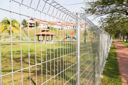 Security fencing at residential neighborhood