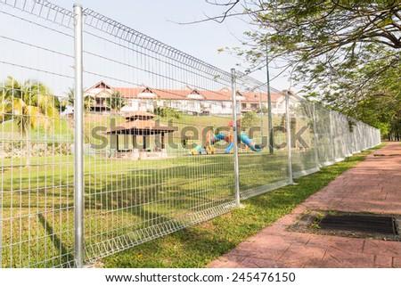 Security fencing at residential neighborhood #245476150