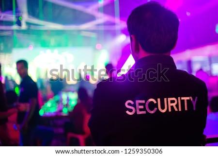 security guard in night club.