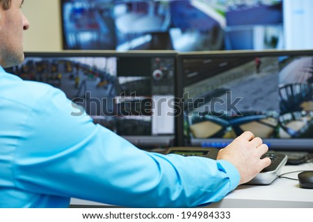 security guard watching and operating video monitoring surveillance security system Сток-фото ©