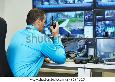 security guard watching video monitoring surveillance security system
