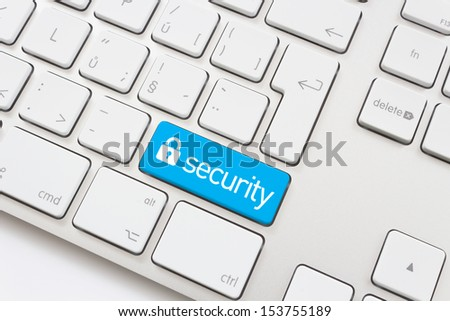 Security key with lock icon on a white keyboard