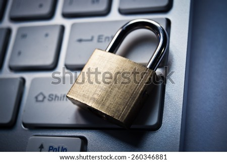 security lock on a computer keyboard - computer security concept