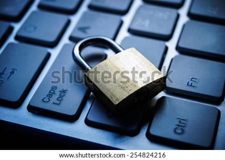 security lock on black computer keyboard - computer security concept