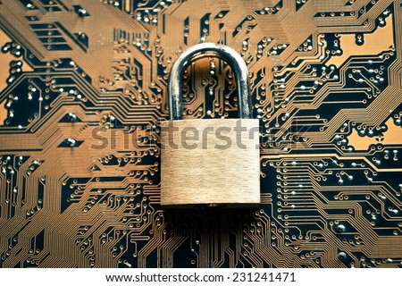 security lock on computer circuit board - computer security concept