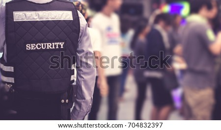 Security man standing indoor / soft focus picture / Vintage concept