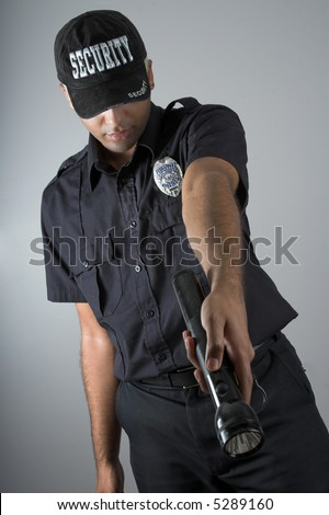 security officer pointing with flashlight