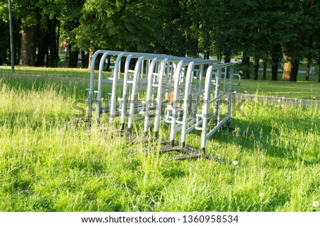 Security. Sections of the metal portable fence in the park before the start of the mass event #1360958534