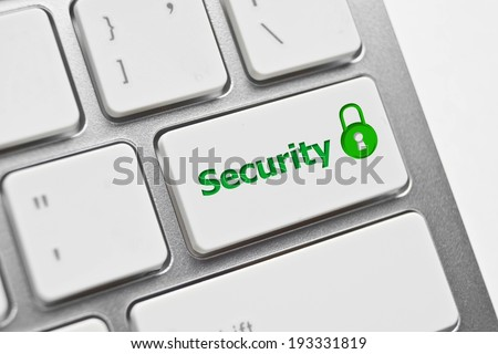 security symbol on computer keyboard with green padlock