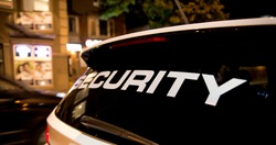 Security vehicle patrolling city at night