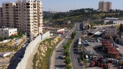 Security wall with Israeli idf watch tower Close to Shuafat Refugee Camp- Aerial Israel, Jerusalem- May/10,2020